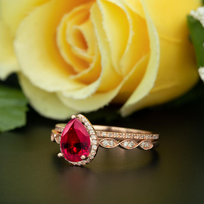 1.5 Carat Pear Cut Halo Ruby and Diamond Ring with Classic Wedding Band in 9k Rose Gold