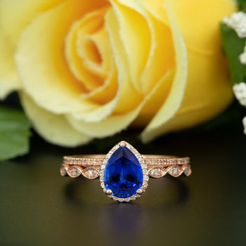1.50 Carat Pear Cut Halo Sapphire and Diamond Bridal Ring Set in Rose Gold