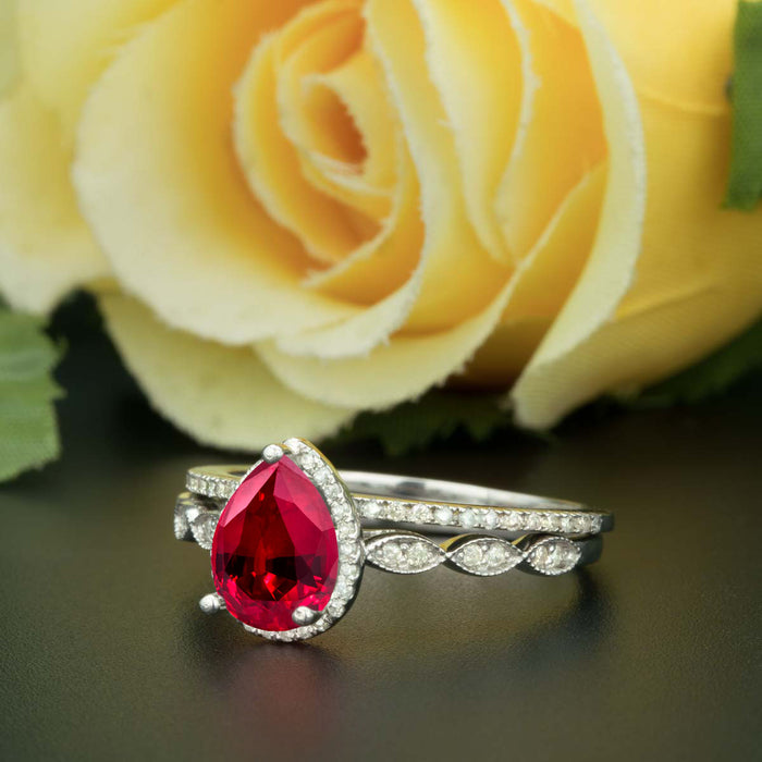 1.5 Carat Pear Cut Halo Ruby and Diamond Ring with Classic Wedding Band in 9k White Gold