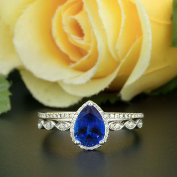 1.50 Carat Pear Cut Halo Sapphire and Diamond Bridal Ring Set in White Gold