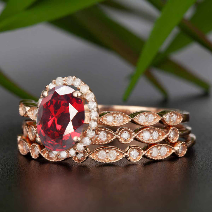 Timeless 2 Carat Oval Cut Ruby and Diamond Trio Bridal Ring Set in 9k Rose Gold