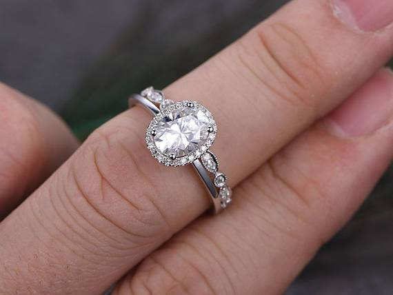 1.50 Carat Oval Cut Moissanite and Diamond Halo Wedding Set in White Gold