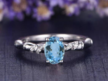 Beautiful 1.25 Carat Oval Cut Aquamarine and Diamond Engagement Ring in White Gold