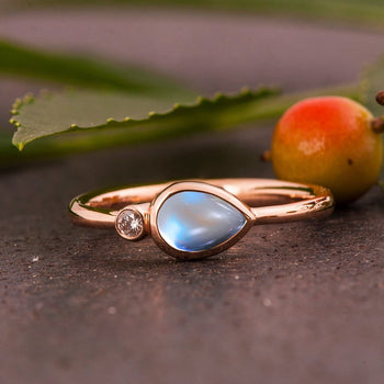Two Stone 1.05 Carat Pear Shape Blue Moonstone and Diamond Bezel Engagement Ring in Rose Gold