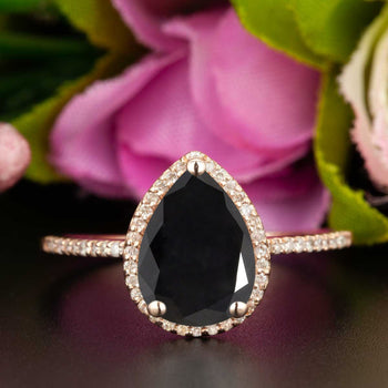 Classic 1.25 Carat Pear Cut Black Diamond and Diamond Engagement Ring in Rose Gold