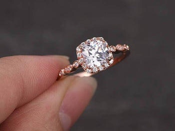 1.50 Carat Round Cut Moissanite and Diamond Halo Wedding Ring in Rose Gold