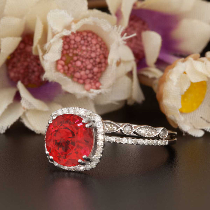 1.5 Carat Cushion Cut Halo Ruby and Diamond Ring with Classic Wedding Band in 9k White Gold