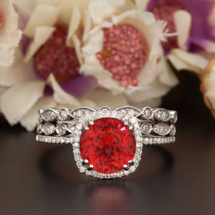 2 Carat Cushion Cut Halo Ruby and Diamond Ring with 2 Classic Wedding Bands in 9k White Gold