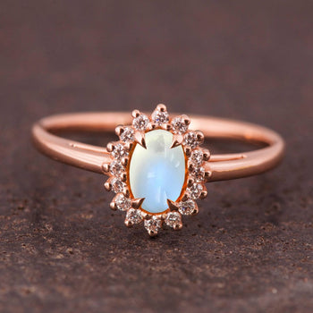 Antique 1.50 Carat Oval Cabochon Cut Blue Moonstone and Diamond Floral Engagement Ring in Rose Gold