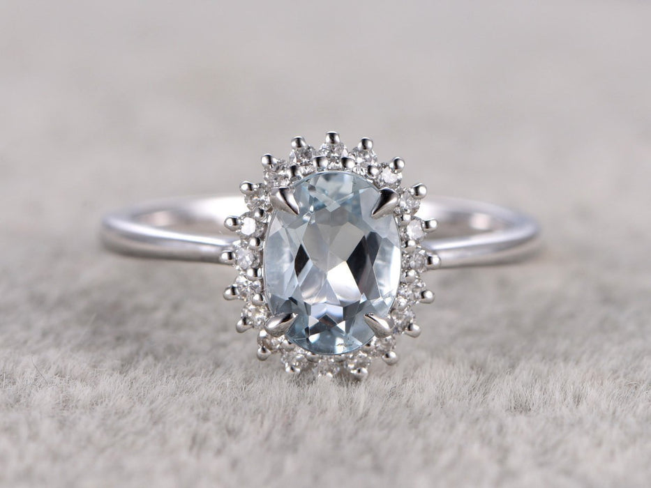 Halo 1.25 Carat Oval cut Aquamarine and Diamond Engagement Ring in White Gold