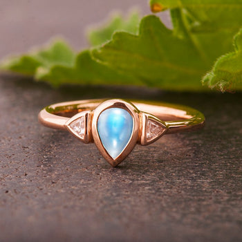 Bezel Setting 1.10 Carat Pear Shape Blue Moonstone and Diamond Three Stone Engagement Ring in Rose Gold