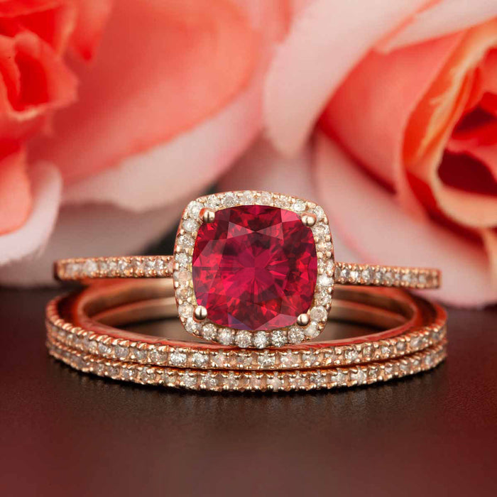 2 Carat Cushion Cut Halo Ruby and Diamond Trio Bridal Ring Set in 9k Rose Gold for Women