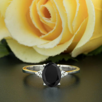 1.25 Carat Oval Cut Black Diamond and Diamond Engagement Ring in White Gold Elegant Ring