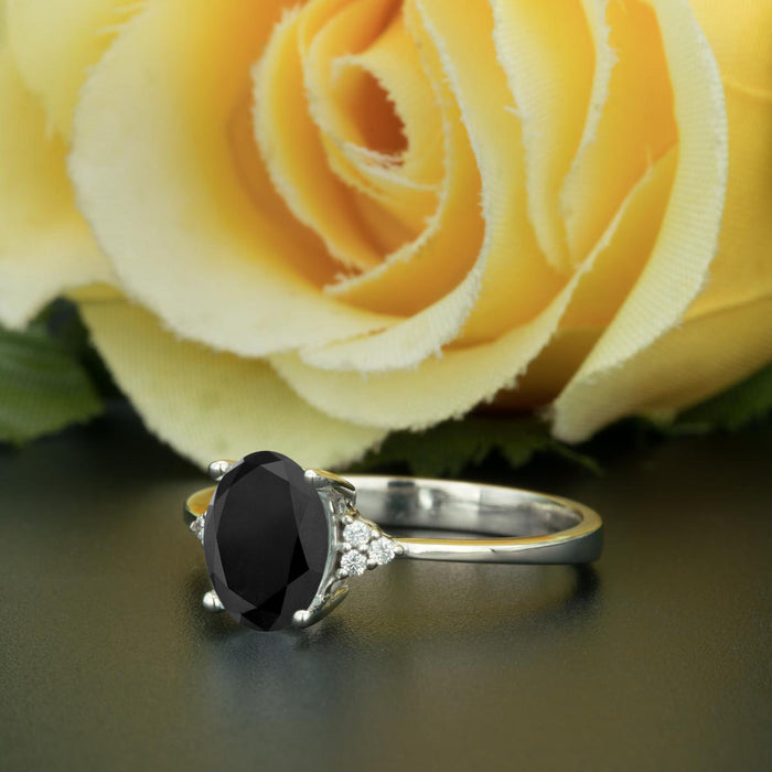 1.25 Carat Oval Cut Black Diamond and Diamond Engagement Ring in 9k White Gold Elegant Ring