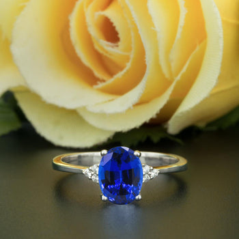 1.25 Carat Oval Cut Sapphire and Diamond Engagement Ring in White Gold Elegant Ring