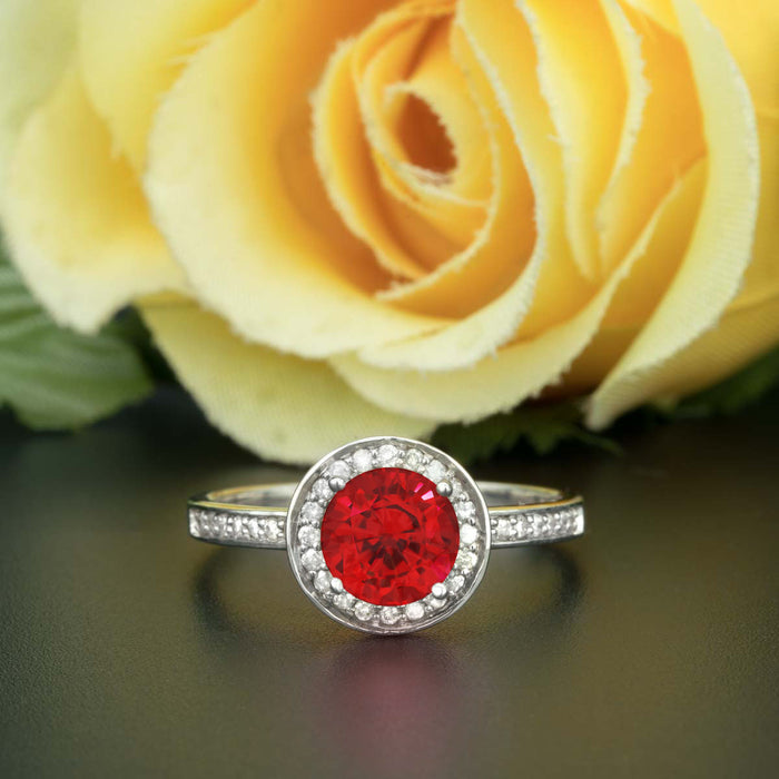 1.25 Carat Round Cut Halo Ruby and Diamond Engagement Ring in 9k White Gold for Women