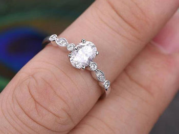 Antique 1.25 Carat Oval Cut Moissanite and Diamond Engagement Ring in 9k White Gold