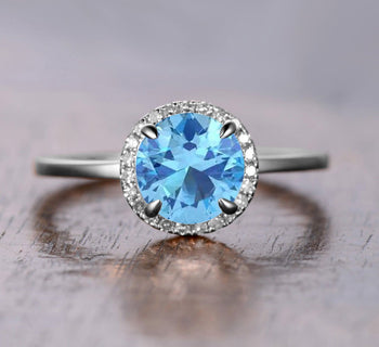 Superb 1.25 Carat Aquamarine and Diamond Halo Engagement Ring in White Gold