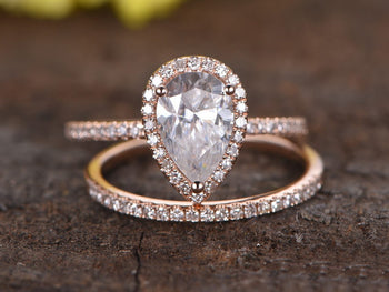 2 Carat Pear Cut Moissanite and Diamond Halo Wedding Set in Rose Gold