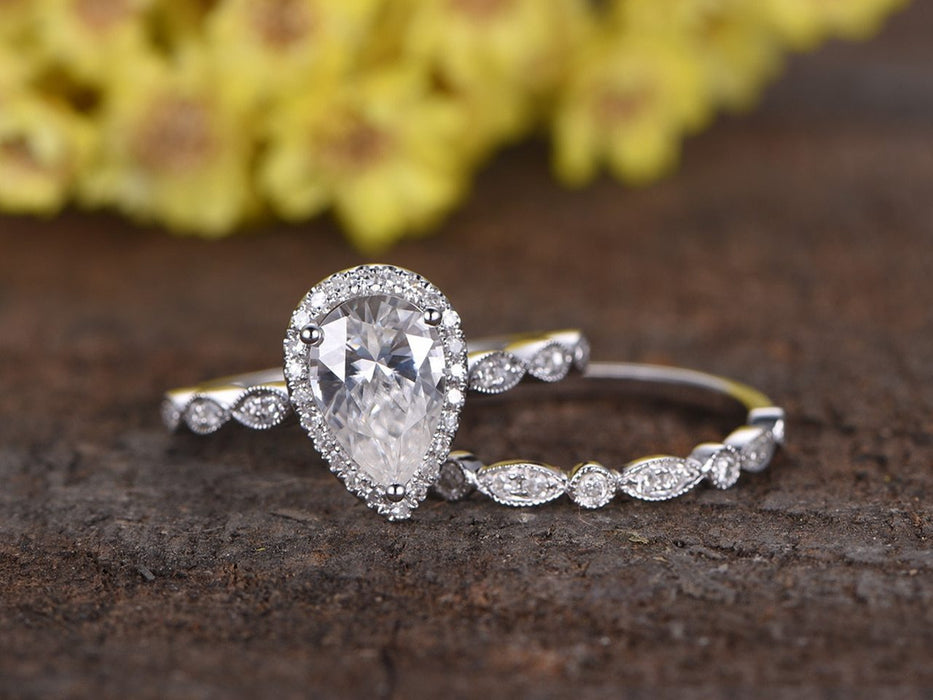 2 Carat Pear Cut Moissanite and Diamond Halo Wedding Set in White Gold