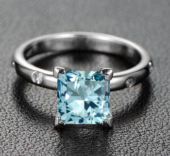 1.25 Carat Princess Cut Aquamarine and Diamond solitaire Engagement Ring in White Gold