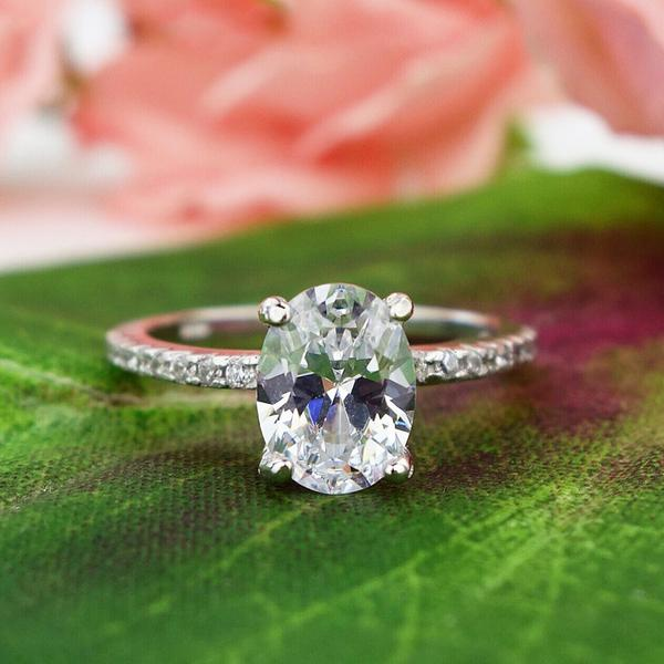 1.25 Carat Oval Cut Accented Engagement Ring in White Gold over Sterling Silver