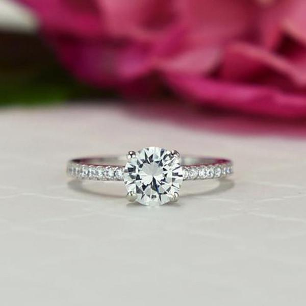 1.25 Carat Round Cut Accented Enagagement Ring in White Gold over Sterling Silver