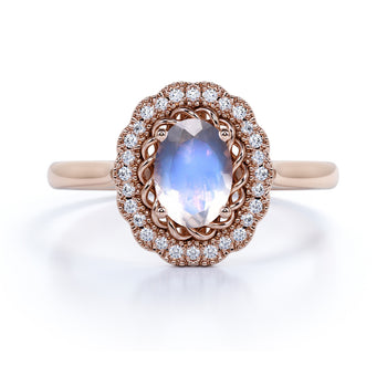 1.50 Carat Antique Oval Blue Moonstone & Diamond Vintage Engagement Ring in Rose Gold
