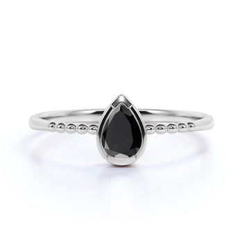 Modern Bezel Set Pear Shaped Black Diamond Minimalist Solitaire Engagement Ring in White Gold