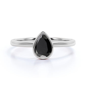 1 Carat Minimalist Bezel Set Pear Shaped Black Diamond Solitaire Engagement Ring in White Gold