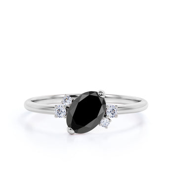 1.50 Carat Oval Cut Black Diamond and White Diamond Accents Cluster Engagement Ring in White Gold