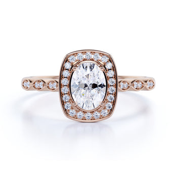 Vintage 1.5 Carat Bezel Set Oval Fire Moissanite & Diamond Halo Engagement Ring in Rose Gold