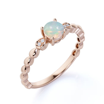Unique 1.25 Carat Natural Round Blue Fire Opal and Diamond Cluster Engagement Ring in Rose Gold