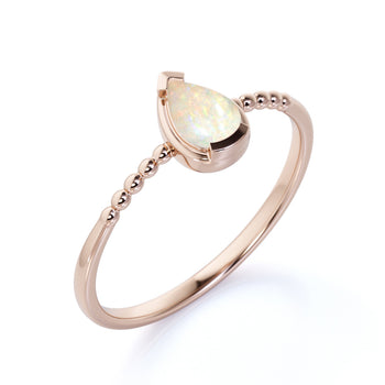 Modern Bezel Set Pear Shaped Fire Opal Minimalist Solitaire Engagement Ring in Rose Gold