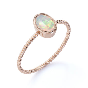 Minimalist Bezel Set 1 Carat Natural Oval Welo Opal Twist Solitaire Engagement Ring in Rose Gold