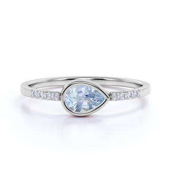 0.51 ct Pear Cut Aquamarine with Pave Set Diamonds Ring in White Gold