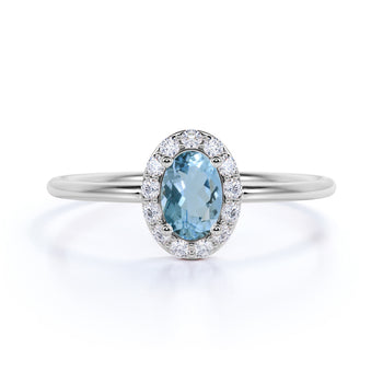 Classic 0.48 Carat  Halo Set Oval Cut Aquamarine and Diamond Dainty Ring in White Gold