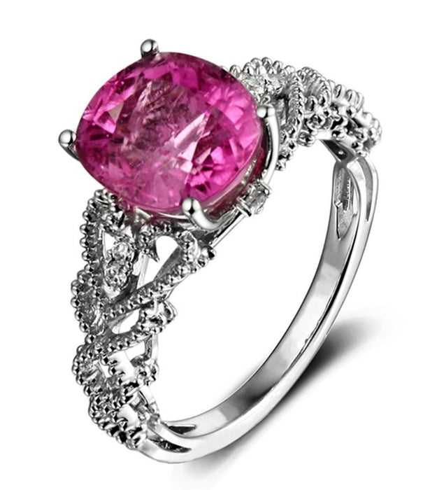 Antique 1.50 Carat Ruby and Diamond Halo Engagement Ring
