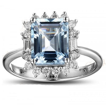 Beautiful 1.50 Carat blue topaz and diamond halo engagement ring