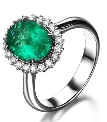 Beautiful 1.50 Carat oval shape Emerald and Diamond Halo Engagement Ring