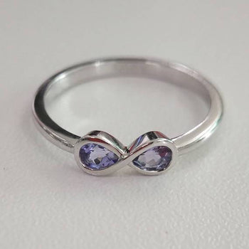 1 Carat Pear Shaped Tanzanite Infinity Design Engagement Rings in White Gold