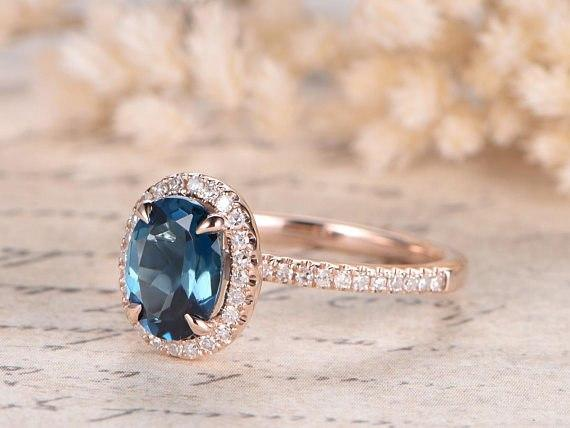 1.50 Carat Oval London Blue Topaz and Diamond Halo Claw Prong Engagement Ring in Rose Gold