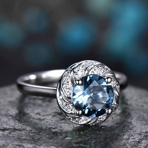 1.25 Carat Round Blue Topaz and Diamond Art Deco Solitaire Engagement Ring in White Gold