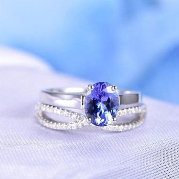 1.50 Carat Oval Cut Tanzanite and Diamond Infinity Design Wedding Ring Set in White Gold