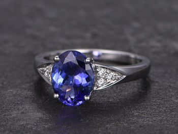 1.25 Carat Oval Cut Tanzanite with Round Cut Diamonds Engagement Ring in White Gold