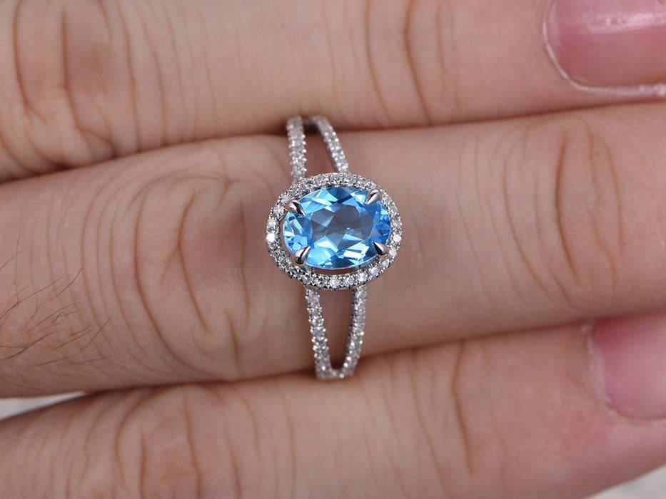 1.50 Carat Oval Cut Sky Blue Topaz and Diamond Halo Claw Prong Split Shank Engagement Ring in White Gold