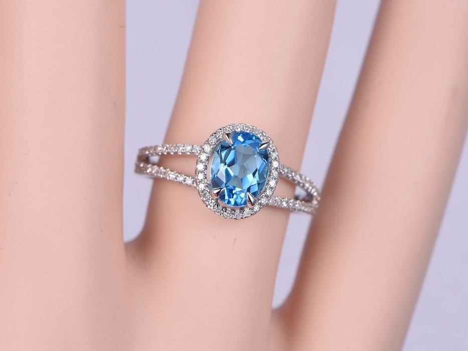 1.50 Carat Oval Sky Topaz and Diamond Halo Split Shank Engagement Ring in White Gold