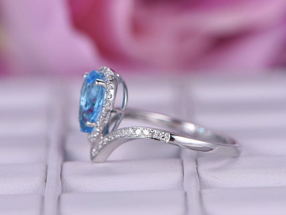 1.25 Carat Pear Cut Sky Topaz and Diamond Unique Curved Engagement Ring in White Gold