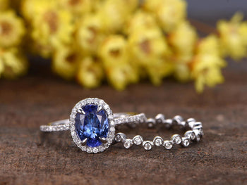 1.50 Carat Oval Cut Tanzanite with Halo Diamond Eternity Design Wedding Ring Set in White Gold