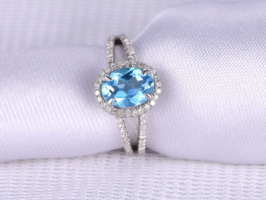 1.50 Carat Oval Sky Topaz and Diamond Split Shank Engagement Ring in White Gold
